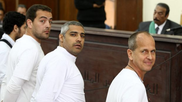Al-Jazeera producer Baher Mohamed, left, Canadian-Egyptian bureau chief Mohammed Fahmy, centre, and Peter Greste in ...