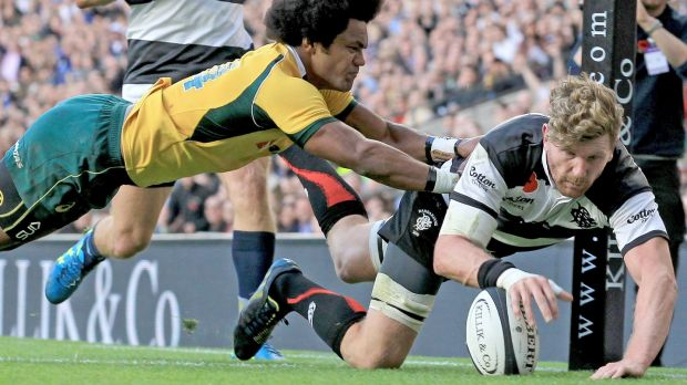 Reds recruit Adam Thomson scores a try for the Barbarians against the Wallabies in November.