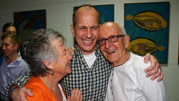 Welcome home son ... Australian journalist Peter Greste is hugged by his mother Lois, left, and father Juris, right, ...