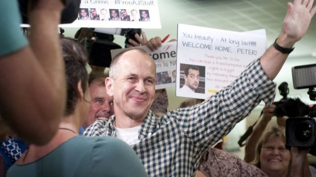 Peter Greste greets supporters on his return to Brisbane.