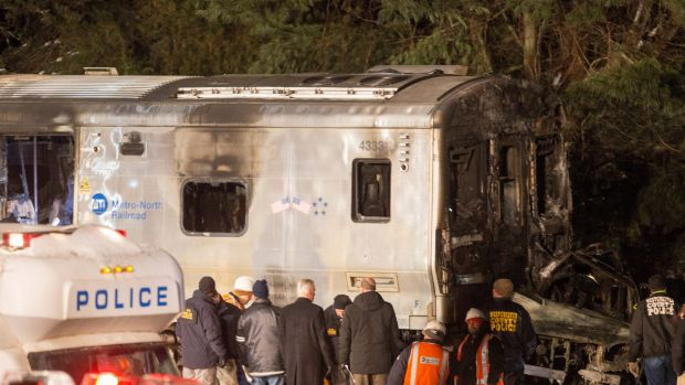Metropolitan Transportation Authority workers and police investigate the Metro-North train crash.