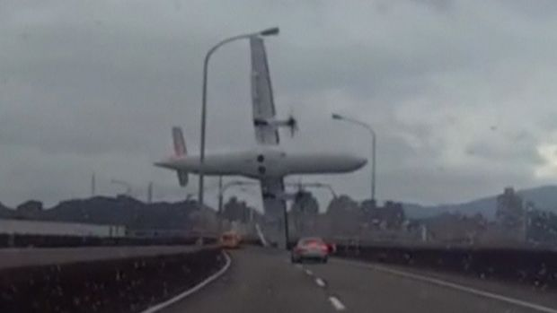 A video shot by a motorist shows a TransAsia Airways plane cartwheeling over a motorway soon after take-off.