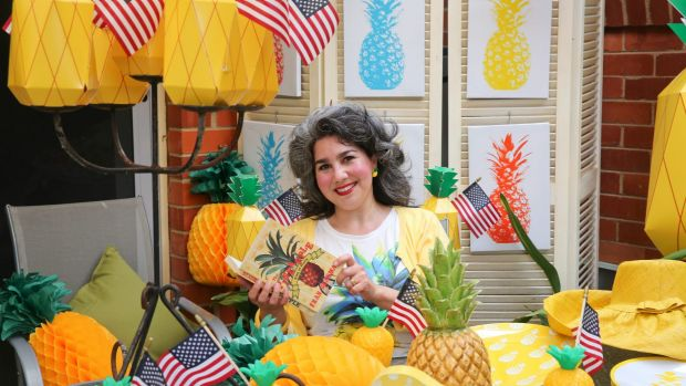 Canberra Australian American Association President Alicia Doherty prepares for her pineapple-themed experience at the ...