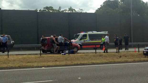 Police and ambulance at the scene of a crash that ended a high speed chase just south of the border on the M1.