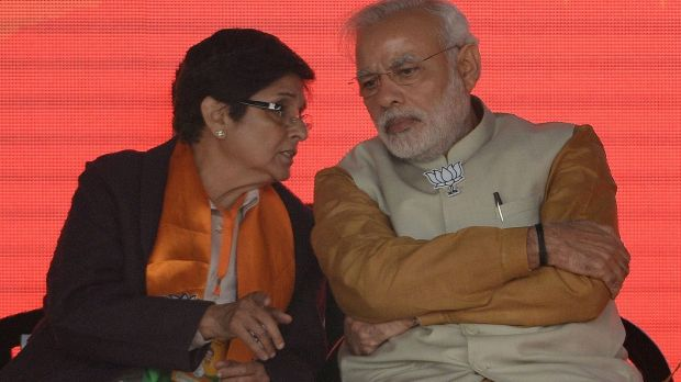 Indian Prime Minister Narendra Modi talks with the Bharatiya Janata Party candidate for Delhi chief minister, Kiran ...