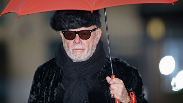 Gary Glitter arrives at the London court to hear his sentencing.