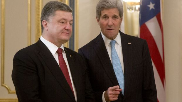 "US Secretary of State John Kerry (right) told Ukrainian President Petro Poroshenko Washington ""will not close our eyes"" ..."