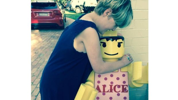 Charlie Bigg-Wither's daughter Alison and her lego statue he believes was stolen on Thursday night.