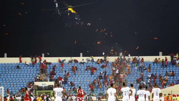 A helicopter hovered overhead as harassed officials dithered over whether or not to abandon the game.