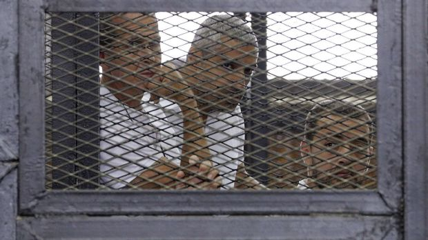 Al-Jazeera journalists (from left) Peter Greste, Mohammed Fahmy and Baher Mohamed  in a Cairo court in June 2014.