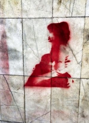 A stencil on a Cairo wall shows the moment that activist and poet Shaimaa al-Sabbagh was shot and died in a colleague's arms.