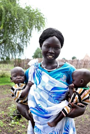 Nyabang Lul, 23, brings her twin daughters Nyajuok and Nyatut, right,   to be screened for malnutrition at The Save the ...