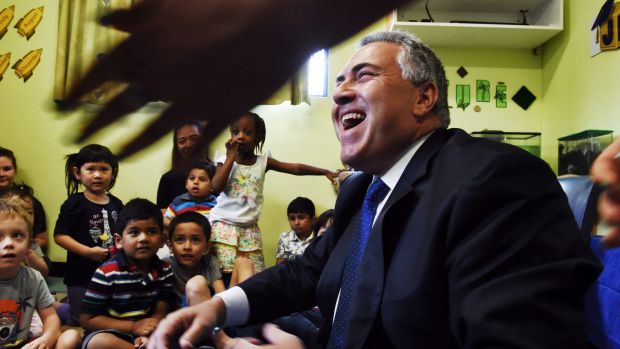 Child cheer: Joe Hockey at a Childcare centre in Padstow.
