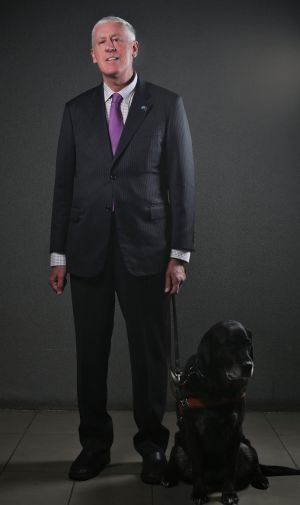 Graeme Innes, former federal disability discrimination commissioner, with his guide dog Arrow.