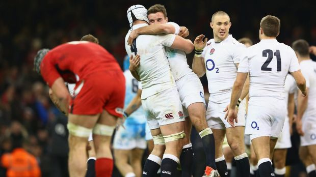 Final whistle: England players celebrate as Wales are vanquished at home.