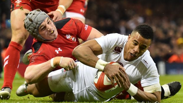 That'll do: England wing Anthony Watson touches down to score at the Millennium Stadium.