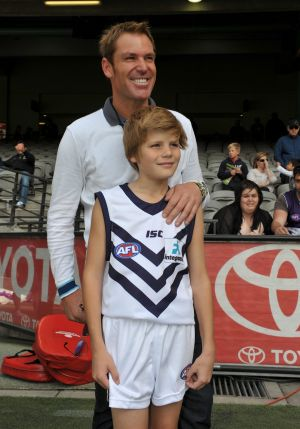Shane and Jackson Warne in 2011.