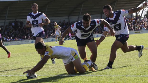 Jeremy Hawkins scores the first of his two tries against the Storm.
