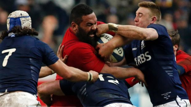 Huge unit: France's Uini Atonio is tackled by Scotland's Blair Cowan (L) and Dougie Fife (R).