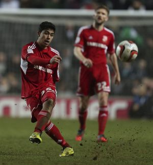 Club colours: Massimo Luongo puts boot to ball for Swindon Town.