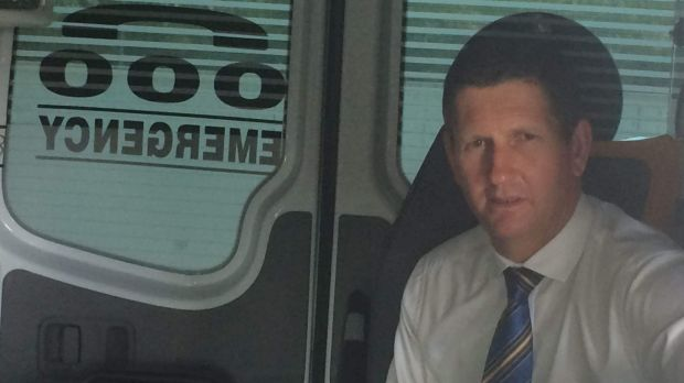 LNP leader Lawrence Springborg visits a Brisbane ambulance station, projecting business as usual while the state ...