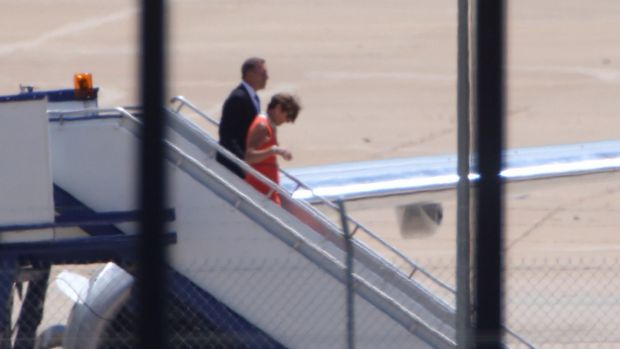 Prime Minister Tony Abbott and his wife Margie arrive in Canberra on Sunday.
