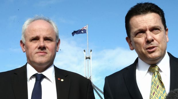 Senators John Madigan and Nick Xenophon have said they will vote against the Abbott government's bid to abolish the ...