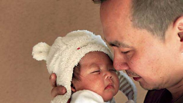 Jason Zheng with his two-month-old son, Alexander. <i>Picture: Jacky Ghossein</i>