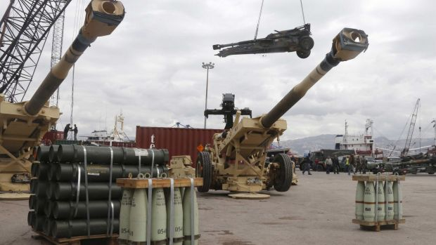 Workers unload artillery, part of a military donation from the US government to the Lebanese army, in Beirut on Sunday.