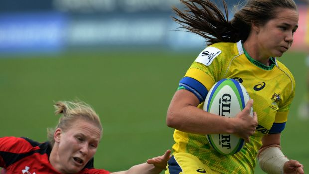Denied again: Chloe Dalton of Australia runs to score a try during  semi-final against Canada but for the second ...