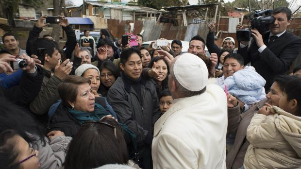 Pope Francis made a surprise visit to a shantytown on Rome's outskirts on Sunday, stunning poor residents, many of them ...