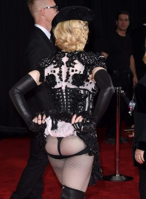 Always ahead of the curve, Madonna attends last year's Grammys wearing a G-string.