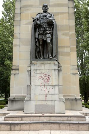 The King George Memorial in front of Old Parliament House has been vandalised with red spray paint.