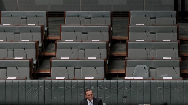 Prime Minister Tony Abbott cuts a lonely figure in Parliament on Monday.