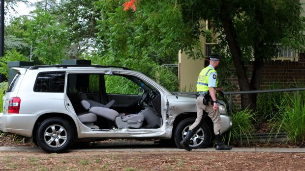 ACT Policing at the scene of a two vehicle collision at the corner of Doonkuna Street and Ainslie Avenue in Braddon.