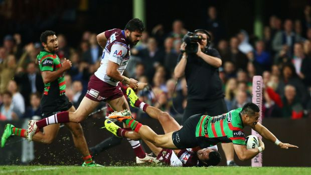 Gone: Kirisome Auva'a of the Rabbitohs scores a try during the season last year but has been edited out of a club video.