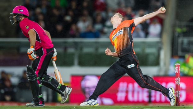 Big hit: Jason Behrendorff bowls during the Big Bash League Final at Manuka Oval last month.