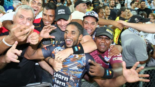 Mobbed: Preston Campbell is hailed by jubilant fans after the inaugural Indigenous All Stars match in 2010.