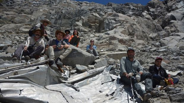 Chilean mountaineers pose  on what they say is the wreckage of a plane that crashed in the Andes 54 years ago.
