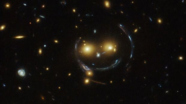 In the center of this image, taken with the Hubble Space Telescope, is the galaxy cluster SDSS J1038+4849 — and it seems ...
