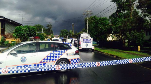 Police at the scene of a fatal stabbing in Logan Central.