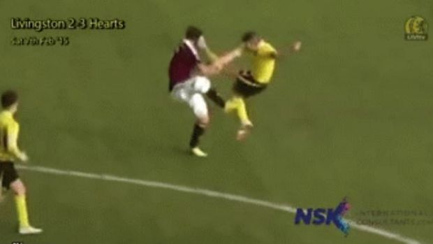Sam Nicholson takes a blow to the face from the boot of the Livingston captain.