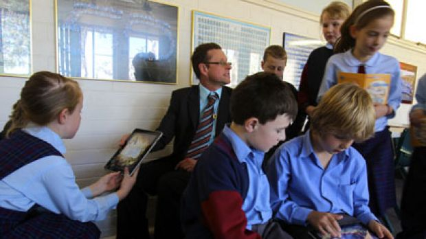 """""""I get my best writing from students this way"""" ... Tim Butt with pupils at St Finbar's Primary School. The class is ..."""