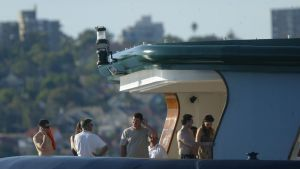 Old friends: James Packer in 2005 aboard Arctic P with Tom Cruise and Katie Holmes (right) and Tommy Davis (shirtless, ...