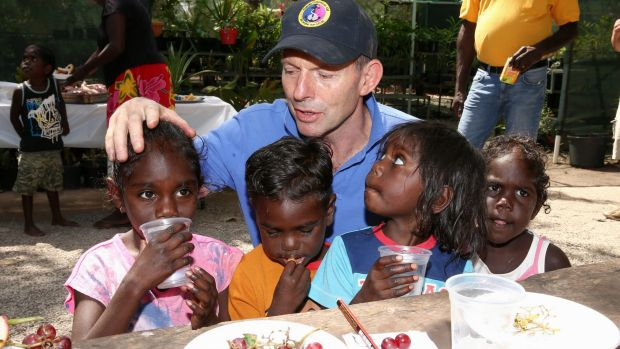 Tony Abbott meets with children from the Gunyangara community during a visit to North East Arnhem Land last year.
