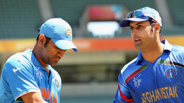 MS Dhoni (L) of India and Mohammad Nabi of Afghanistan shake hands at the coin toss.