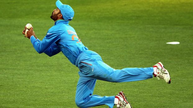 Shikhar Dhawan of India attempts to take a catch.