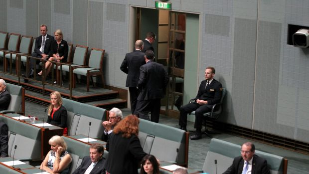 A group of Coalition MPs walk out of the chamber while Opposition Leader Bill Shorten raised the budget in his Closing ...