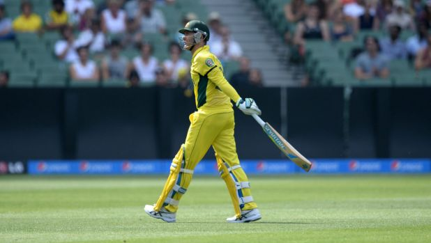 On the way out: Australia's Michael Clarke walks off the ground after being dismissed against the United Arab Emirates ...
