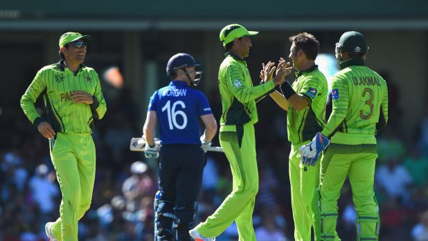 Walk of shame: England captain Eoin Morgan leaves the field on Wednesday as Pakistan celebrate.